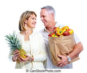 Senior couple with a shopping bag.