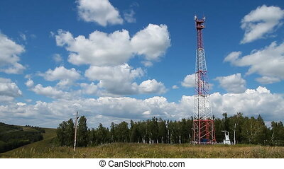 Communications tower 006 - High transmitter tower against...