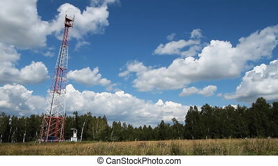 Communications tower 011 - High transmitter tower against...