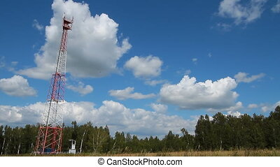 Communications tower 001 - High transmitter tower against...