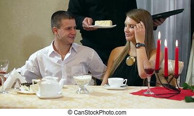 waiter serves dessert