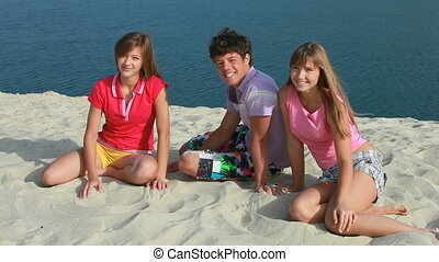 At seaside - Three teenagers enjoying themselves at seashore...