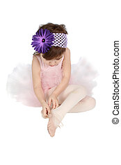 Ballet girl - Little ballet girl putting on her shoes