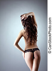 Young naked woman stand - show spine and hairs