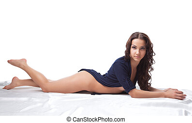 Beauty naked woman lay on white in knitted jacket