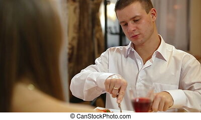 couple having dinner in a restaurant DOF