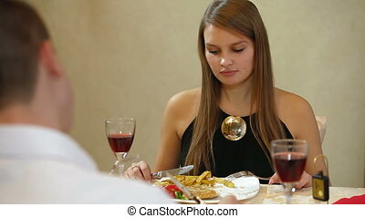 dining out - Young beautiful couple having a dinner in a...