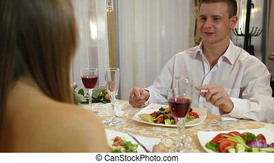 Romantic Fine Dining - Romantic couple having dinner. DOF...