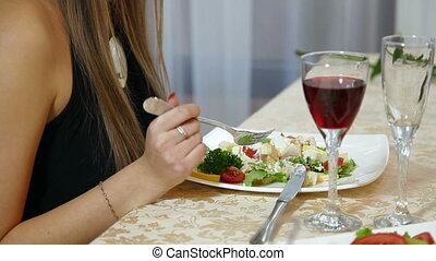 Young Woman dinner in  restaurant