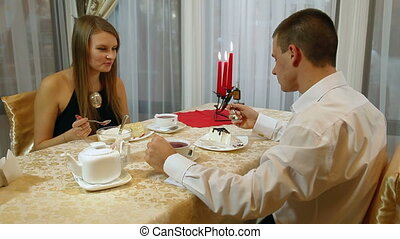 tea and dessert - young couple eating dessert
