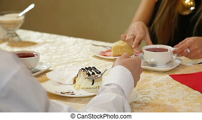 cheesecake dessert - young couple enjoying a dessert in a...