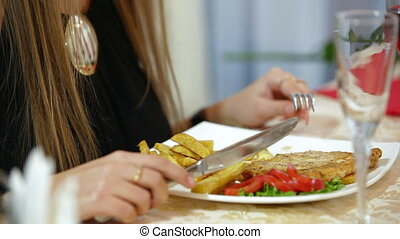 dining out - Young woman dinner in a restaurant