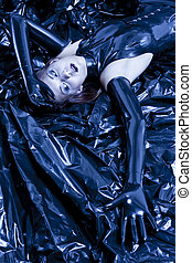 portrait of lying woman wearing latex clothes