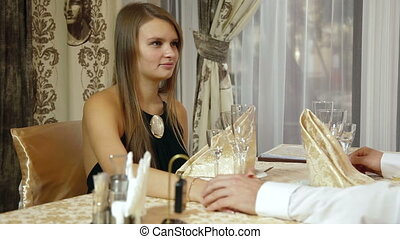 Lovely Dinner - A young couple talking at restaurant