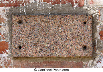 Old brick wall with a blank marble slab, for backgrounds or...