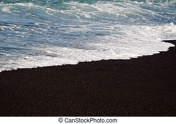 Black volcanic sand beach - Black volcanic sand on the beach...