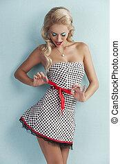 sensual pin girl up playing with ribbon