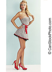 sensual pin up with red shoes - pinup style portrait of a...