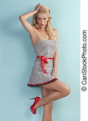 sensual pin up girl with a red belt - pinup style portrait...