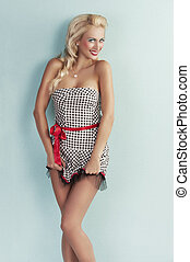 smiling pin up girl playing with dress