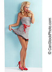 sensual flirty pin up with a red belt - pinup style portrait...