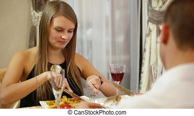 Romantic couple having dinner at restaurant