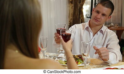 couple celebrating at restaurant - Couple in a romantic...