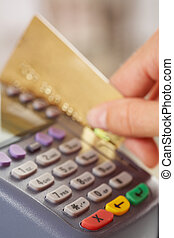 Paying for goods - Close-up of payment machine buttons and...
