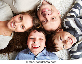 Happy together - A happy family of father, mother and their...