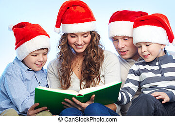 Reading fairy tale - Portrait of four happy family members...