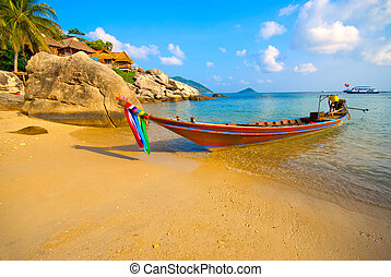 Boat on a beach - Longtail boat on a tropical beach