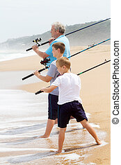 casting fishing lines - grandpa took his grandsons fishing...