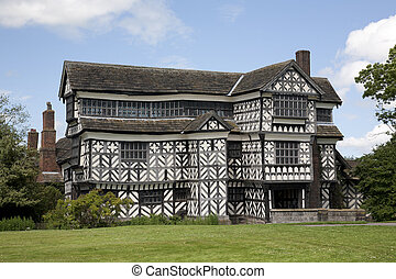 Olde Worlde English Manor House - A picturesque black and...