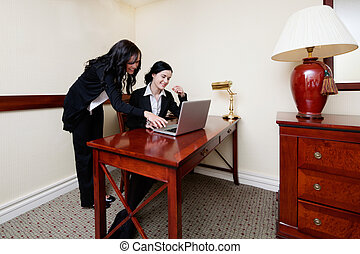 Businesswomen Working on Laptop in Office