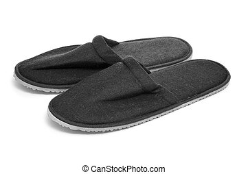 slippers - a pair of black slippers on a white background