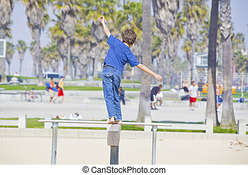 boy playing on balance beam walking away