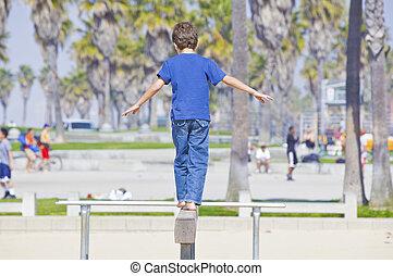 boy playing on balance beam walking away