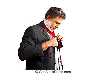 business man holding a speach - business man binding his tie