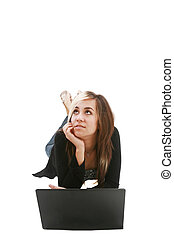 Girl with laptop on floor thinking about something