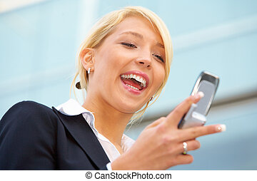 Young Businesswoman - Young businesswoman looking at mobile...
