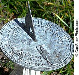 SUNDIAL - A sundial in a garden