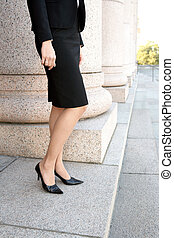 Businesswoman - Young businesswoman standing by colonnade...