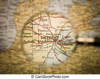 Map of  Detroit - Magnifying Glass in front of a Detroit map