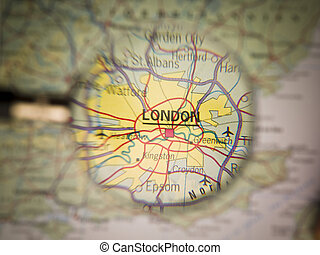 Map of London - Magnifying Glass in front of a London map