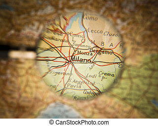 Map of Milano - Magnifying Glass in front of a Milano map