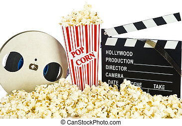 Movie Clapper Board in popcorn with film reel isolated on...