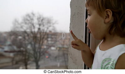 child window - An image of child stands outside the window.