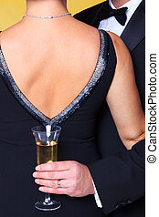 Couple in evening wear embrace - Photo of a couple in black...