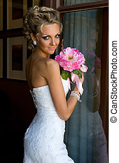 Beautiful bride with bunch of flowers - Beautiful bride is...