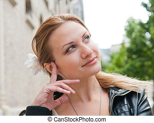 thinking woman - beautiful young attractive woman outdoors...